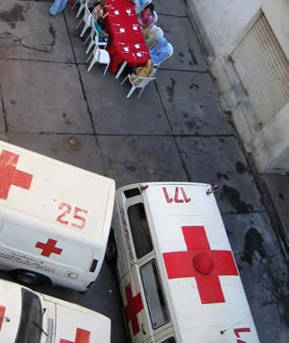 http://www.zombietime.com/fraud/ambulance/spears_iftar2.jpg